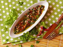 Chimichurri sauce. Garnished with basil, chili, parsley Royalty Free Stock Photos