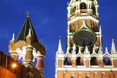 Chiming clock of Spasskaya Tower. Large chiming clock of Spasskaya Tower and Tsatskaya Tower of Kremlin at evening Royalty Free Stock Photo