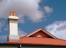 Chimney. And roof gable with blue sky and white clouds royalty free stock photography