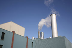 Chimney. Smoking chimney on an industrial building Stock Image