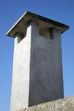 Chimney. Concrete chimney na lue sky isolate Royalty Free Stock Photography