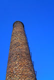 Chimney. Brick chimney isolated on the blue sky Royalty Free Stock Photography