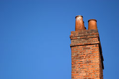 Chimney. A chimney stack against a bright blue sky stock photography