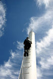 Chimney. Man climbing up a chimney in the summer Stock Images