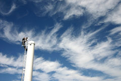 Chimney. Man climbing up a chimney in the summer Royalty Free Stock Photography