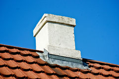 Chimney. A white chimney on a rooftop Royalty Free Stock Image