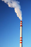 Chimney. Blue sky chimney environment in danger smoke exhaust ecology industrial climate pollution Royalty Free Stock Images