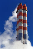 Chimney. Industrial air pollution, red and white chimney royalty free stock photos