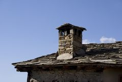 Chimney. Stone roof and chimney in Leshten village Stock Photos