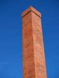 Chimney. Brick chimney against blue sky Royalty Free Stock Images