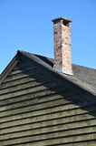 Chimney. A Chimney is on a wood house Royalty Free Stock Image