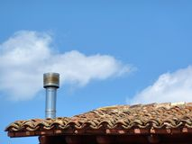Chimney against blue sky Stock Photography