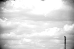 Chimney against clouds wall Royalty Free Stock Photos