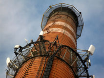 Chimney as a mast for antennas Royalty Free Stock Photos