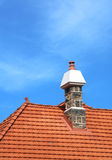 Chimney 1. Chimney atop a roof with red tiles Royalty Free Stock Photo