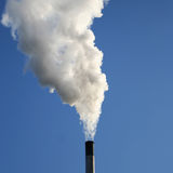 Chimney billowing smoke Stock Image