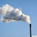 Chimney billowing smoke Royalty Free Stock Images