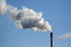 Chimney billowing white smoke Royalty Free Stock Photo