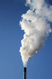 Chimney billowing white smoke Stock Photo