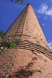 Chimney in the blue sky. An old chimney in Sweden Royalty Free Stock Images