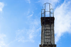 Chimney on blue sky Royalty Free Stock Image