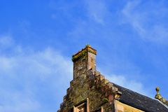 Chimney of a building. This is the chimney of a building against the sky Stock Image