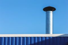 Chimney on building rooftop Royalty Free Stock Photography