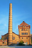 Chimney and buildings of the old slaughterhouse Stock Photos