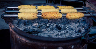 Chimney cakes cooking Stock Images