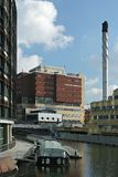 Chimney and canal. The modernised and refurbished Paddington's basin area in London, England. View showing Regent's canal surrounded by modern buildings and a Stock Photo