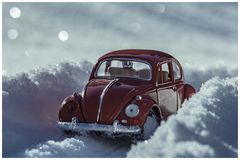 Red toy car stands on a snowy road. In the Swedish forest royalty free stock image