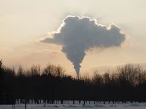 Chimney cloud over city. Ecology and nature - human activity Stock Image