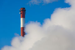 Chimney in clouds of smoke. Stock Photos