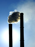 Chimney from coal power-plant. On blue sky Stock Images