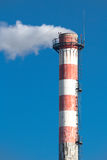 Chimney, concrete, smoke, stripes. Close up of a smoking chimney Royalty Free Stock Photo