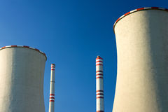 Chimney and coolingtowers of nuclear powerstation. Isolated two chimney and cooling-towers of nuclear powerstation Stock Photography