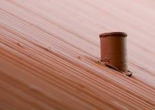 Chimney on corrugated iron roof stock images