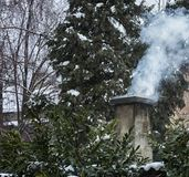 Chimney in the winter time royalty free stock images