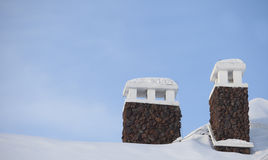 Chimney covered by snow Stock Photos