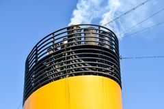 From the chimney of a cruise ship escape smoke and exhaust fumes royalty free stock image
