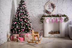 Chimney and decorated xmas tree with gift Royalty Free Stock Photos