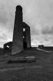Chimney and Derelict Building at Magpie Mine. A chimney and some derelict buildings at a disused mine, Magpie Mine, in the Peak District Stock Images