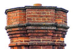 Chimney detail. A red bricked chimney against a white background Royalty Free Stock Image