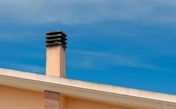 Chimney. Dirty chimney under a blue sky Stock Image