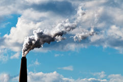 Chimney exhaust waste amount of CO2. Into the atmosphere on a sunny day Stock Photo