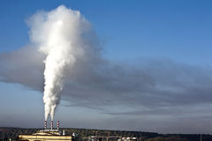 Chimney expelling pollutant gases to the air Stock Photo
