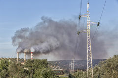 Chimney expelling pollutant gases to the air. Spain Royalty Free Stock Image