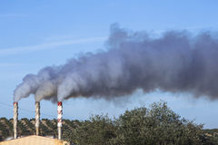 Chimney expelling pollutant gases to the air, Spain Stock Photography