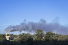 Chimney expelling pollutant gases to the air, Spain Royalty Free Stock Photography