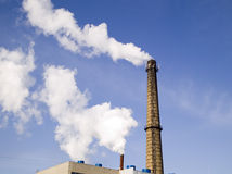 Chimney of factory with smoke Royalty Free Stock Photos